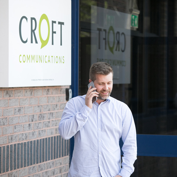 A Croft Communications team member making a call using a business mobile