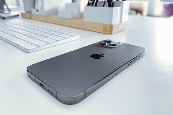The back of an iPhone placed on a desk